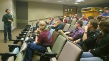 Dr. Tony Gherghetta leading a discussion after a screening of Particle Fever