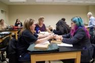 Students and educators assembling and balancing nails in a hands-on experience in the lab rooms
