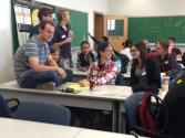 """Students playing """"Photon Torpedo"""" during a break in the meeting."""