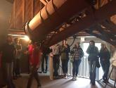 Students at Lowell Observatory touring the telescope used to discover Pluto.