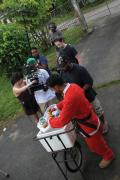 Harnarine and his film crew shoot near a market in Trinidad. Photos by Elizabeth Harnarine.