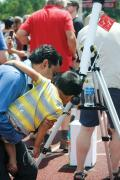 Community members at William Jewell College view the partial eclipse from a telescope equipped with a solar filter. Photo by Cara Dahlor.