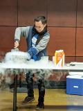 A student helps make liquid nitrogen ice cream.