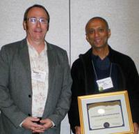 David Donnelly (l) presents Ajay Narayanan with the 2012 Outstanding Chapter Advisor Award