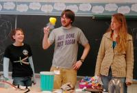 College of Wooster Physics Club members entertain elementary school children with physics demos.