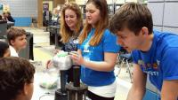 """UCA SPS members take their show on the road for """"Science Nights"""" events by traveling to elementary schools with demonstrations for all attendees."""